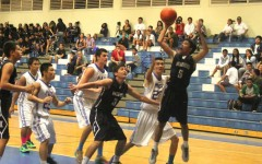 Experienced boys basketball Sabers beat Warriors