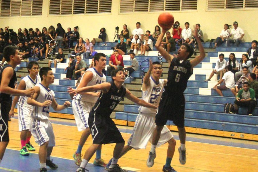 Experienced boys basketball Sabers beat Warriors