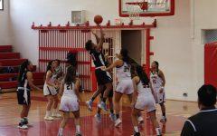 Preseason: Trojans narrowly defeat girls basketball
