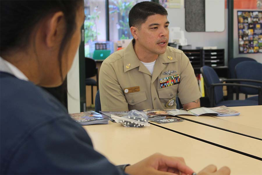 Darrell Degrazia, U.S. Naval Recruiter, talks to students about joining the Navy in Pauahilani, Dec. 6.