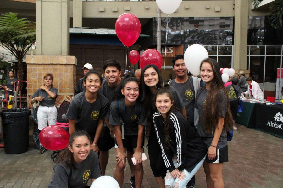 Eight+juniors+and+two+adults+walked+in+the+Family+Care+Giver+event+to+support+Analis+Nitta+in+her+senior+project+at+Queen+Ka%27ahumanu+Center+on+Feb.+25%2C+2017.+The+Warriors+are+all+smiles+while+waiting+for+the+walk+to+begin.