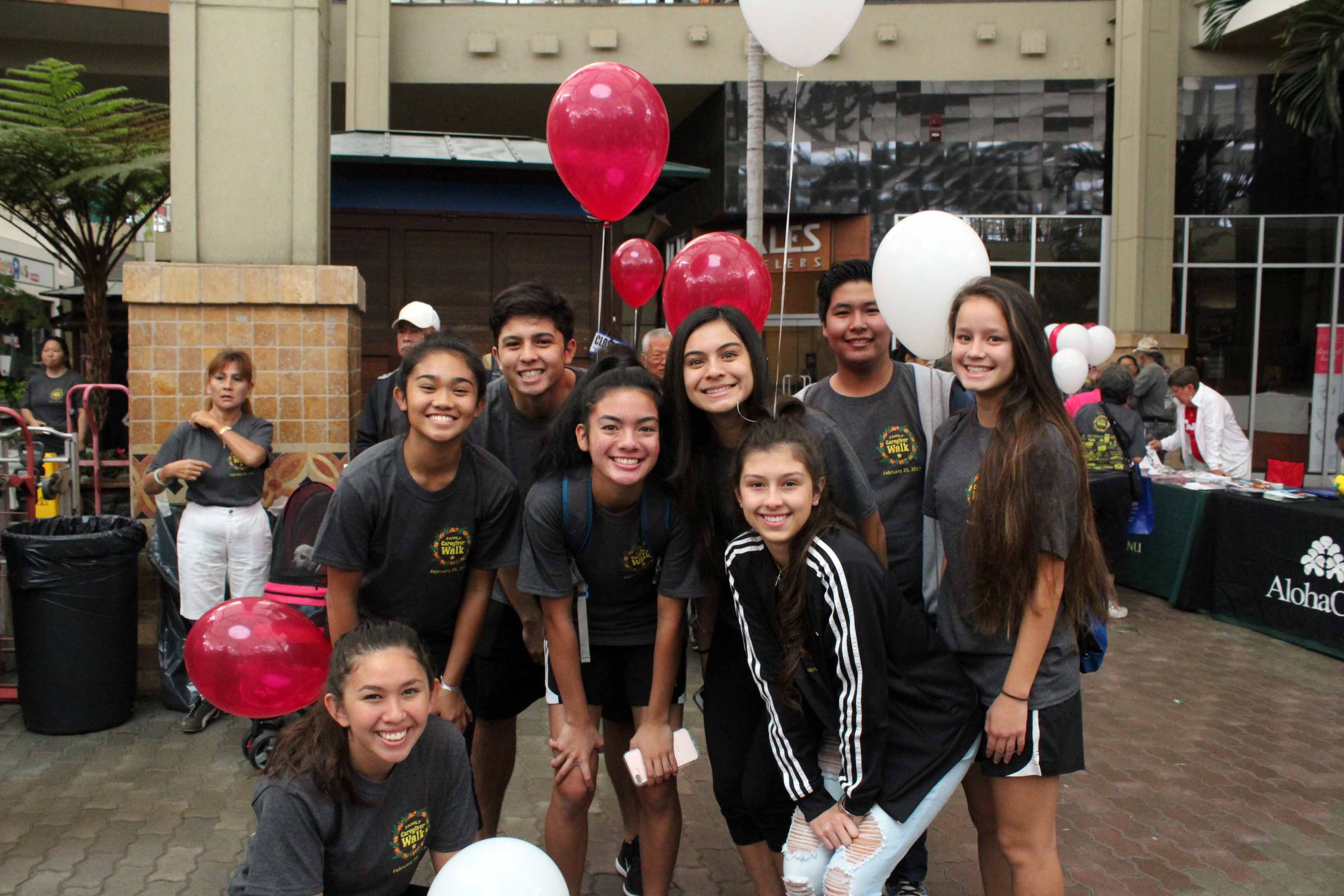 Eight juniors and two adults walked in the Family Care Giver event to support Analis Nitta in her senior project at Queen Ka'ahumanu Center on Feb. 25, 2017. The Warriors are all smiles while waiting for the walk to begin.