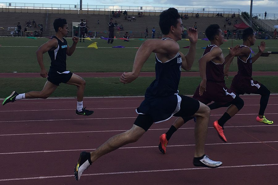 Junior+Spencer+Keanini+competes+in+the+boys+100-meter+dash+in+the+5th+track+and+field+meet+last+night.+Teammates+and+many+family+and+friends+cheered+the+athletes+on+as+they+ran.+A+few+of+the+Warriors+made+the+top+eight+in+their+event+and+competed+in+Saturday%27s+finals+as+well.