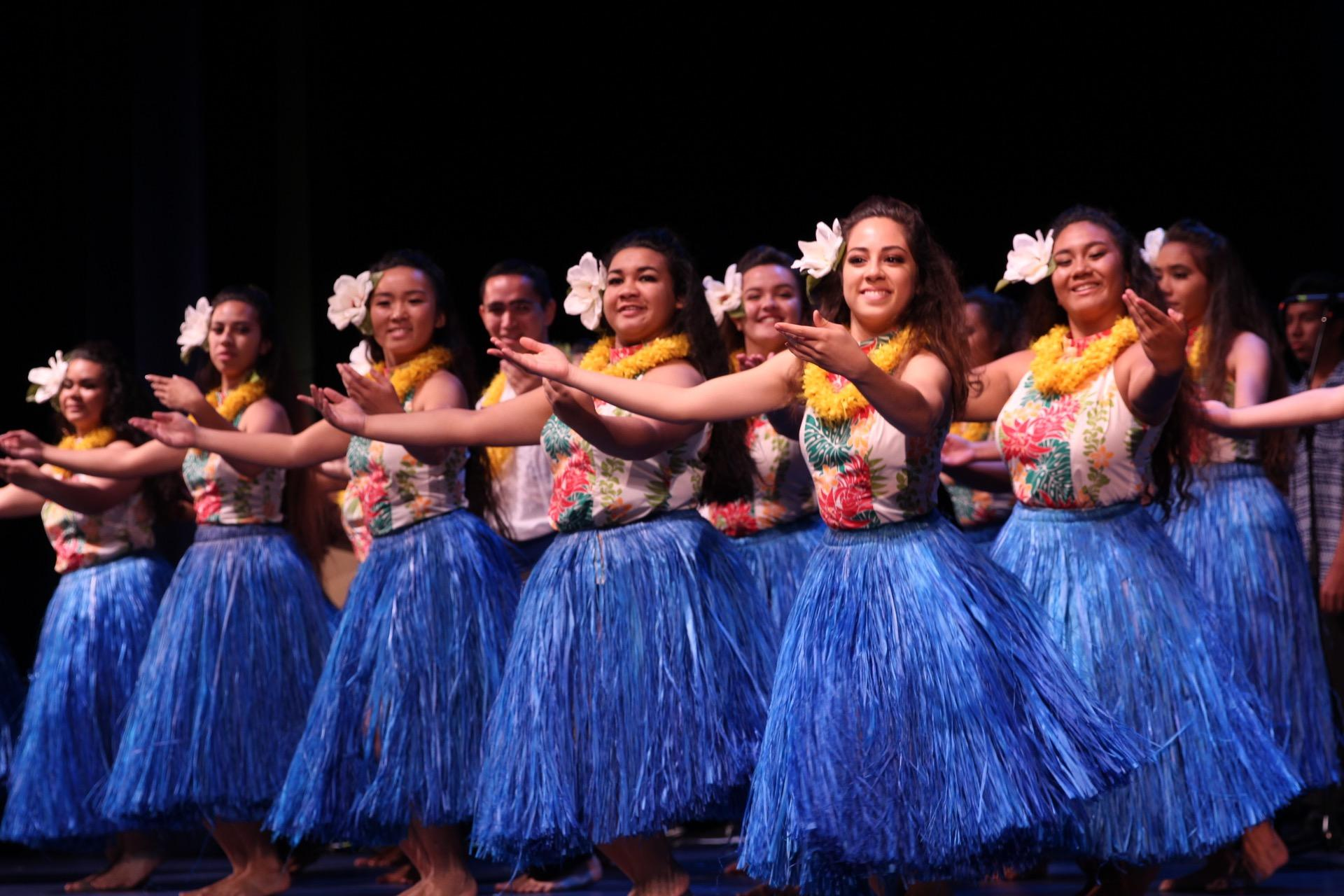 The Hawaiian Ensembleʻs hula group performs to the mele sung by the choir. The Hawaiian Ensemble hosted an open dress rehearsal to make final changes and for the participants' ʻohana to watch.