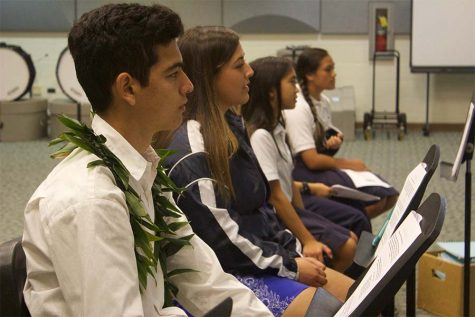 Sophomores Christian Niles, Analicia Kapua and a few sixth-and-seventh graders listen to Ms. Kim and her introduction on drumline.