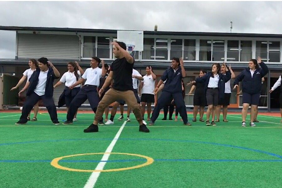 Hawaiian+Ensemble+students+showcase+the+haka+at+one+of+the+schools+they+visited+in+Aotearoa+in+late+March.+At+the+school%2C+the+group+was+split+into+three+teams+to+attend+workshops.+One+involved+learning+the+haka.+