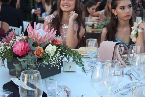 An array of pastel floral centerpieces were part of the table decorations, along with numerous lit candles and the dinnerware. Decor for the night was rustic, with shimmer originating from the glimmer of the chandeliers beaming off the clear-roofed tent.