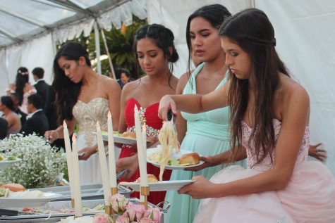 Junior Chloe Lawrence helps herself to food catered by Four Sisters.