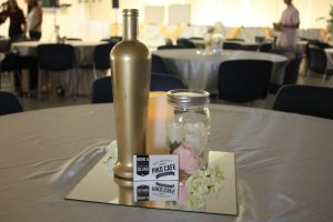 Tables were decorated with pastel colored vases with roses and scattered with Piko Cafe coupons.