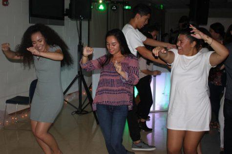 Seniors Tatiana Mendez, Abby Kaina, and Destiney Hamasaki dance together.