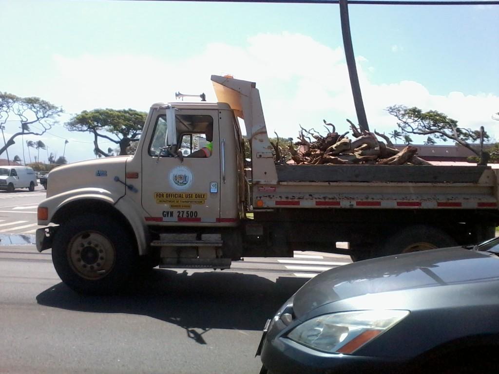 Maui County truck hauling tsunami debris