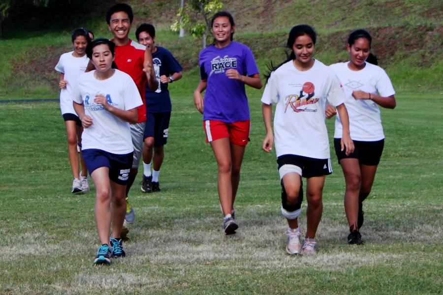 Cross country team working harder