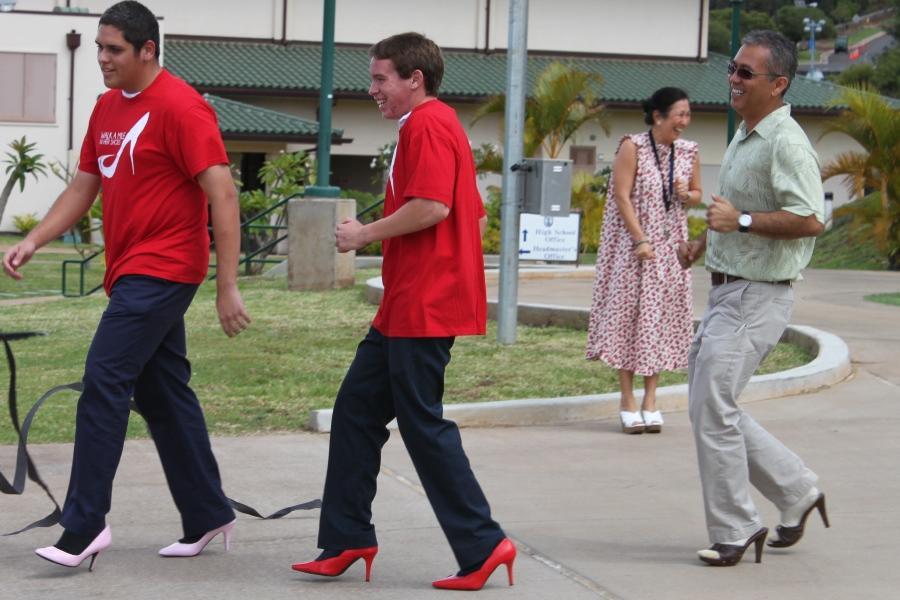 KSM guys take a walk in women's shoes