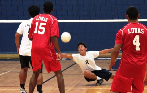 Junior Kekoa Uyechi save the ball while playing against the Lahainalunas at the KS gym on April 10, 2012. The Warriors lost three of the four sets.