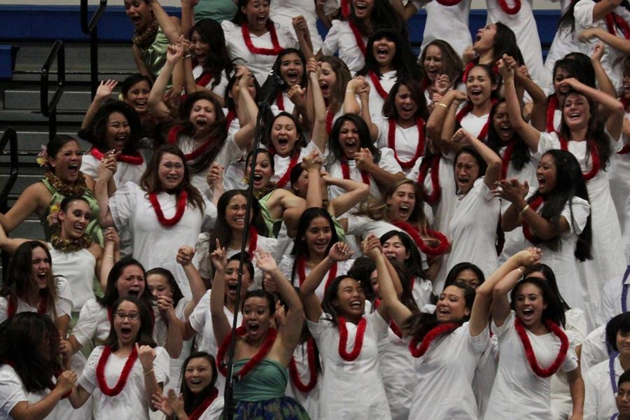 Senior+women+celebrate+their+win+at+%CA%BBAha+Mele+on+April+27%2C+2012+in+Kana%CA%BBiaupuni+Gymnasium.+The+senior+class+of+2012+were+the+victors+this+year%2C+performing+%22%CA%BB%C5%8Ciwi+Medley%22+under+the+direction+of+senior+Keala+Kama.