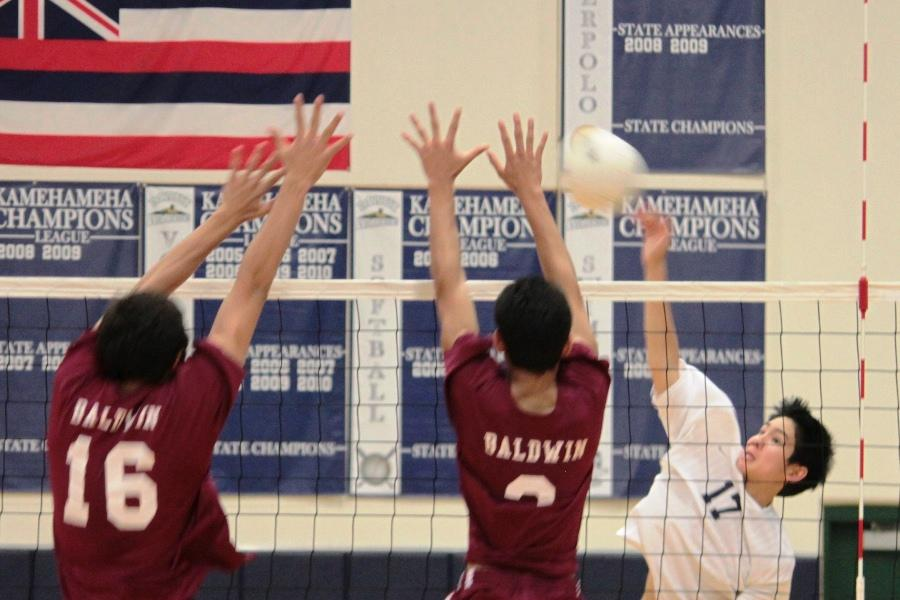 Junior Kawelau Yen hits the ball over the net at the KS gym on April 5, 2012 in a game against the Baldwin Bears. The Warriors lost three of the four sets, bringing them to 1-7 this season.