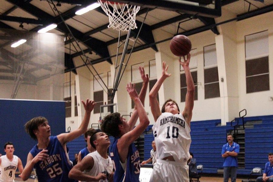 JV Boys Basketball shoots, scores over Spartans