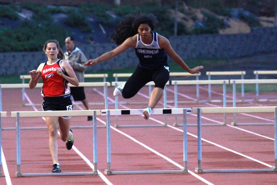 Senior Raven Poepoe jumps a hurdle during the girls 300 meter hurdle event at the Yamamoto Invitational finals on March 23, 2013.