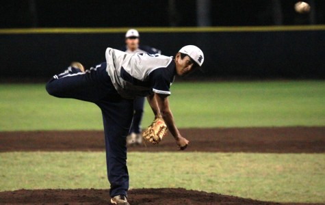 TJ Kanamu pitches a ball against the Maui High Sabers at the Iron Maehara Stadium on March 27, 2013. The Warriors lost 2-6.