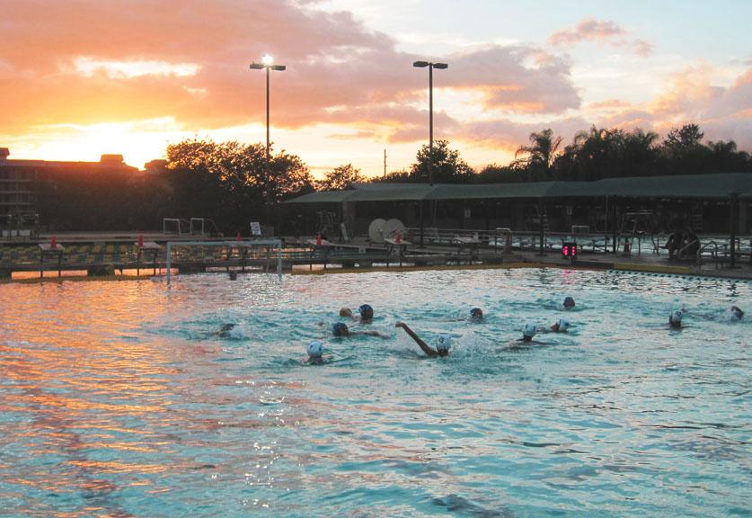 Both+KSM+Warriors+and+MHS+Sabers+water+polo+team+play+under+the+sunset+at+the+Kihei+Aquatic+Center+on+March+28%2C+2013.