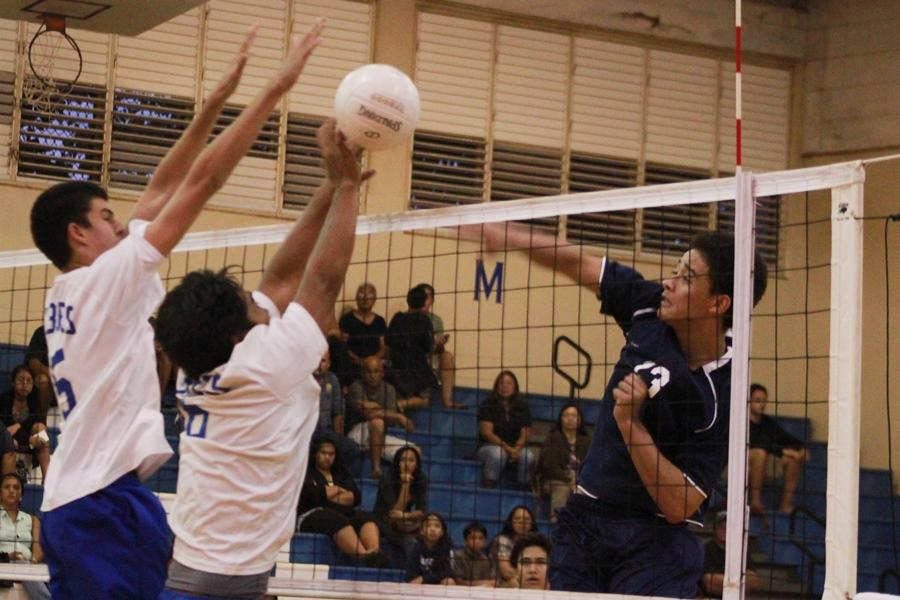 Senior Kahiau Andrade goes for a kill against two Maui High School players during a game on Tuesday, April 9, 2013 at the Maui High School Gymnasium. The KSM Warriors won all three sets against the Sabers.