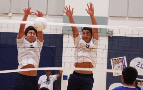 Kekoa Uyechi and Mana Aikala block against a hit by the Maui High Sabers on April 23, 2013. The Warriors lost in four sets on their senior night.