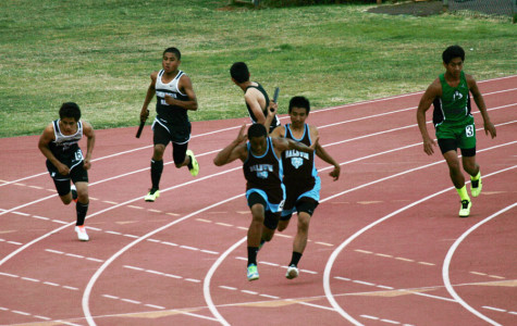Freshman Rayne Poepoe runs to switch off with Freshman Covy Cremer in the boys' 4x100 relay at the JV Track & Field championships on Friday, April 19, 2013, at the War Memorial Stadium.