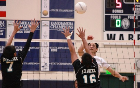 Senior RJ Moku hits over the KKHS Nā Aliʻi on April 4, 2013. The Warriors won in all three sets, keeping a fair lead on the Nā Aliʻi for the most of the game.
