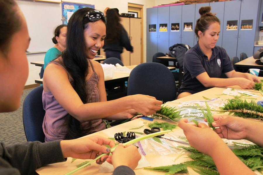 Kumu+Tori+Hulali+Canha+and+senior+Kylie+Wahineho%27okae+make+lei+in+preparation+for+the+2013+Malia+Craver+Hula+Kahiko+Competition+held+on+Saturday%2C+May+11%2C+2013%2C+at+the+St.+Louis+High+School+Gymnasium.