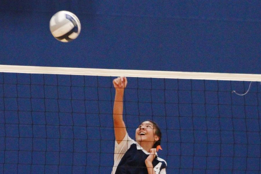 Noelani Poepoe pops the ball over the net in the last game of the season for junior varsity girls volleyball. The Maui Warriors won 3-0 against the Baldwin Bears, and finished their season 10(W) - 3(L).