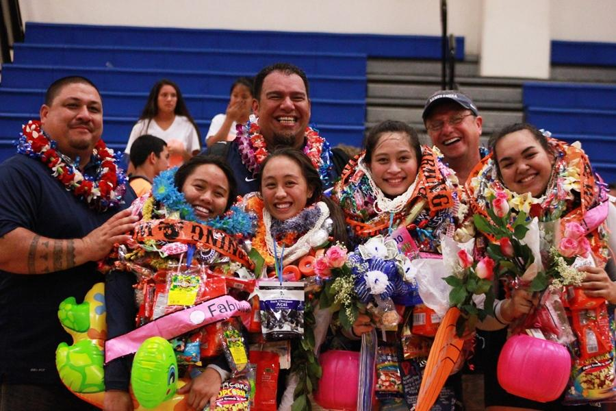 Girls+volleyball+seniors+Shalia+Kamakaokalani%2C+Taylor+Awai%2C+Charity+Sadang%2C+and+Patricia+Batoon%2C+with+their+coaches%2C+are+covered+in+gifts+after+a+senior+night+3-0+win+against+Baldwin+High+School+on+Friday%2C+October+11%2C+at+Ka%27ulaheanuiokamoku.