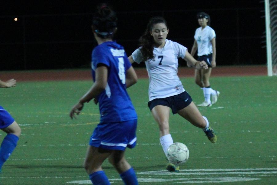 Lily Higashino dribbles during the Warriors' game against the Maui High Sabers on Dec. 28. The Warriors won with a final score of 3-0.