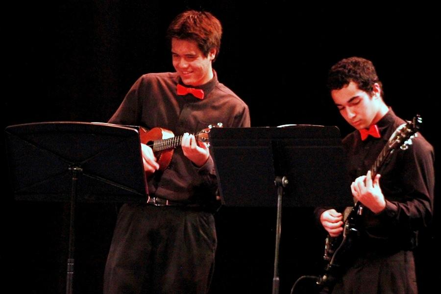 Mikaele Kane contributed his impressive ʻukulele skills alongside Aidan Lay on electric guitar for the jazz rock ensemble performance at the annual Winter Band Concert, Dec. 4, in Keōpūolani Hale.