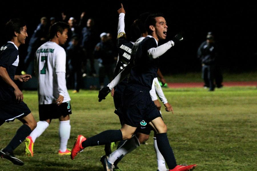 Sophomore Brennan Joaquin celebrates after the first goal of the night is scored by senior Daniel Quenga. The Warriors won the nail-biter of a match with a score of 2-1 and clinched a state berth.