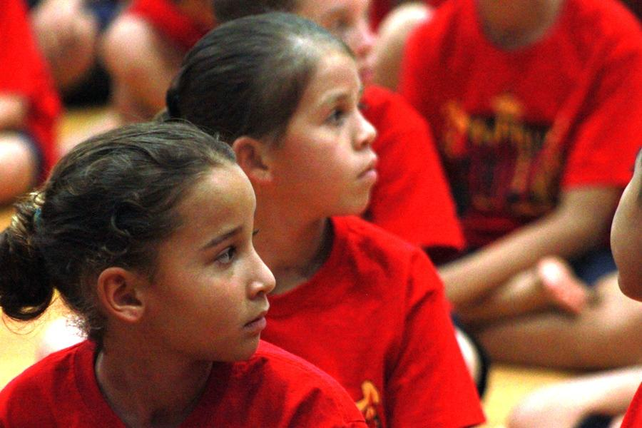 Elementary students Ava, grade 3, and Makamae, grade 4, listen to instructions at rehearsal. Except for the final performance, the entire school day was devoted to learning about and practicing the hula.
