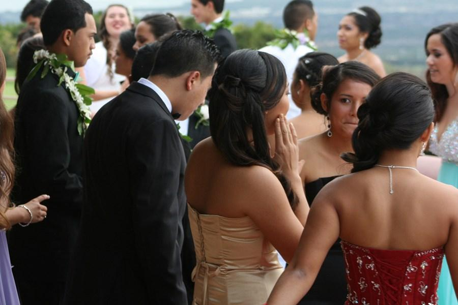 The junior class of 2015 mingles outside on the balcony of the Kamehameha Golf Course, where their prom was held on March 29, 2014.