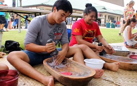 Elijah Won and Kamaile Pahukoa pound kalo into poi during the 10th Annual Hoʻolauleʻa today, May 3, 2014, at the Kamehameha Schools Maui Campus.