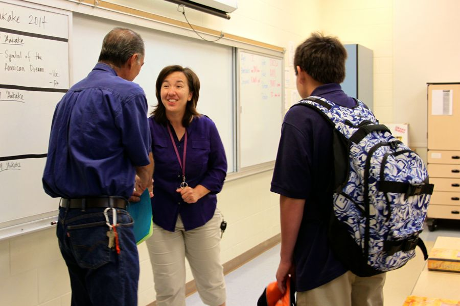Sophomore Zack Fasi and parent, Mr. Paul Fasi, meet 10th grade English teacher, Mrs. Yatsushiro. Students and parents met with teachers for one-on-one conversations after team presentations at Open House, August 26, 2014.