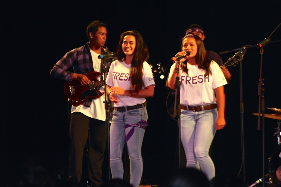 Freshman+singers+%28left%29+Keala+Cabanilla+and+Makamae+Aquino+performed+for+their+first+time%2C+with+a+little+help+from+the+senior+band%2C+at+Battle+of+the+Bands+on+Monday+Sept.+22+at+Ke%C5%8Dpuolani+Hale.