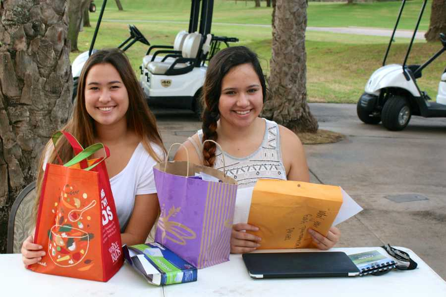 Seniors Rachel Kaulupali and Tyra Kuia-Fernandez organized the Whoʻs Your Caddy charity golf tournament for their senior project at The Dunes at Maui Lani Golf Course, Saturday morning.