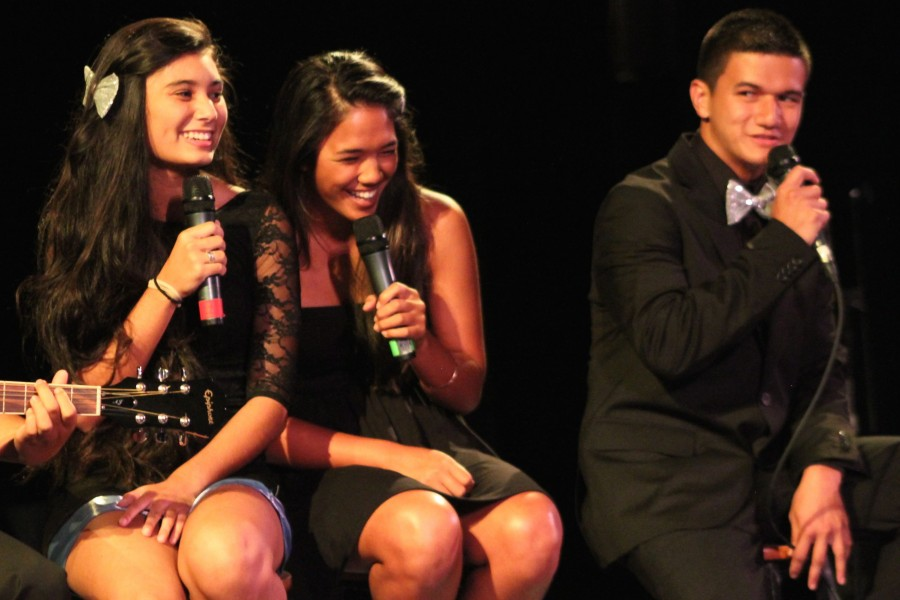 Seniors Kale'a Borling, Jessica Mendiola, and Edward Juan share giggles between tunes during Battle of the Bands at Keōpūolani Hale on Monday, Sept. 22.