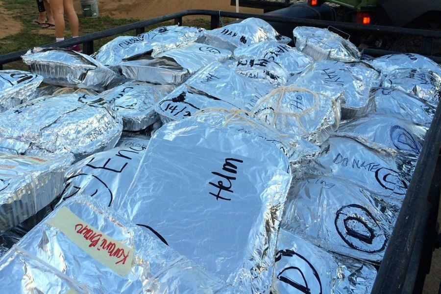 Labeled+turkeys+are+loaded+on+a+trailer+to+be+transported+from+the+drop+off+point+to+the+imu+site+on+Wednesday%2C+preparation+night.