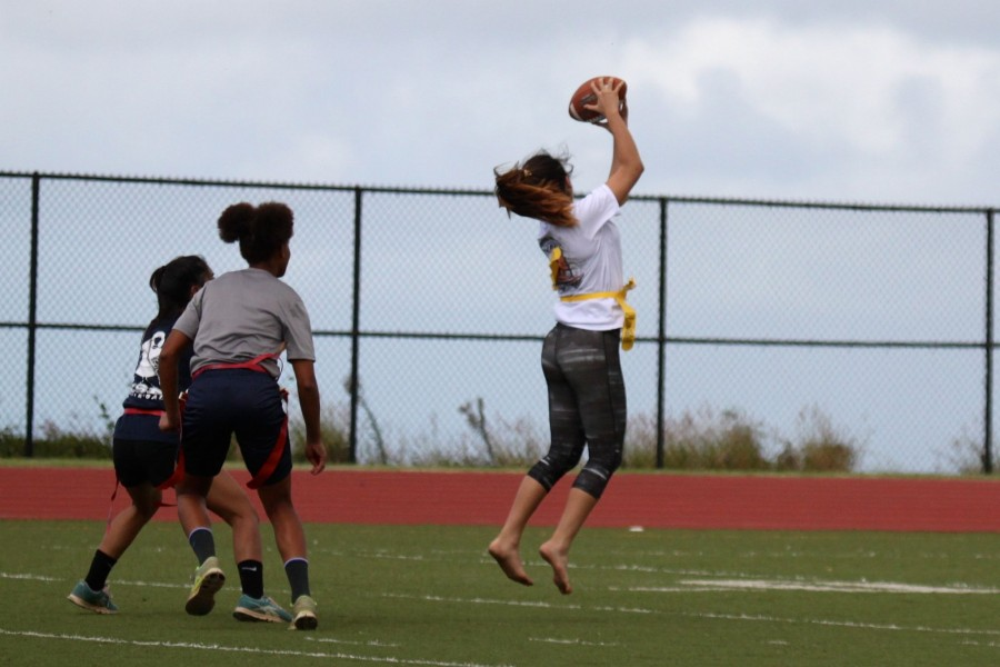 Freshman+Kaylee+Cambra+jumps+for+to+catch+the+ball+during+the+powder+puff+flag+football+game+on+Wednesday+at+Kana%27iaupuni+Stadium.