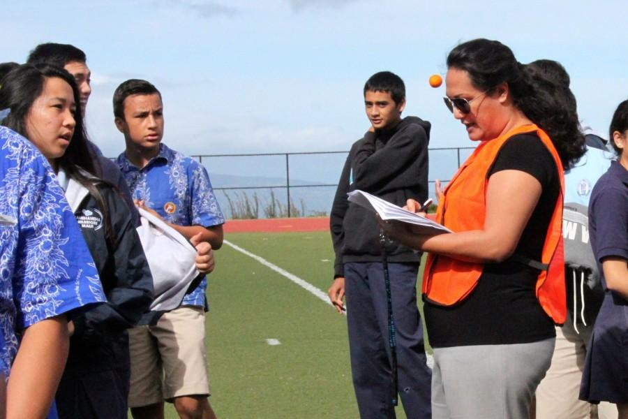 Ms.+Kaulana+Molina+checks+in+her+third+period+Health+students+during+the+evacuation+drill+at+Kana%27iaupuni+Stadium+field+on+Wednesday+December+17.
