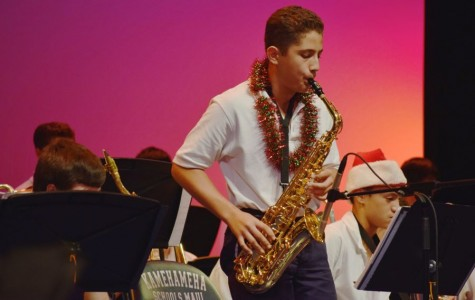 8th grader Makana Saito-Takabayashi performed solos the entire night impressing the audience with his talent from three years playing the saxophone at the Winter Band Concert in Keōpūolani Hale last night.