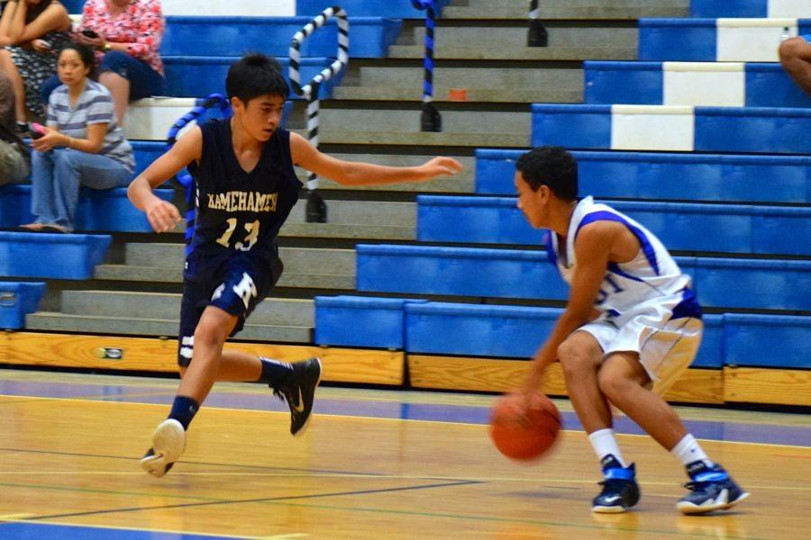 Freshman Austin Peters defends against Saber Chey Higashiguchi on Tuesday, January 27, at the Maui HIgh School gym. The Sabers won.