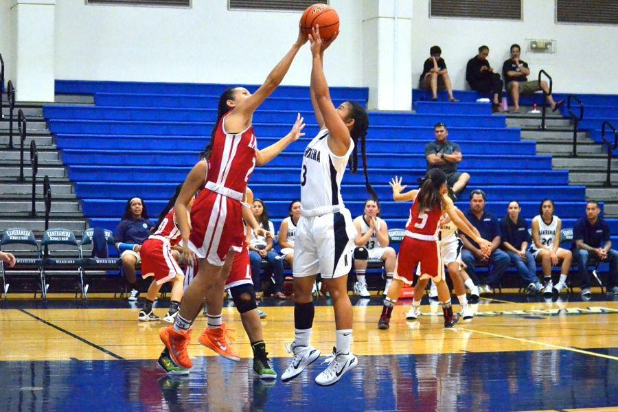 Megan Miguel falls short on a jump shot as Fiemea Hafoka of Lāhainaluna blocks at Ka'ulaheanuiokamoku, January 22, 2014. The Lunas dominated the short-handed Warriors and won, 76-19.