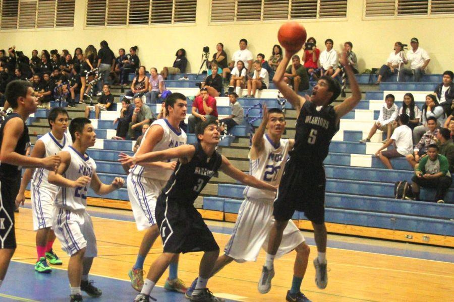 Sophomore Jacob-Charles Espania goes for the rebound last night against Maui High. The game ended with a win for the Sabers, 69 - 41.
