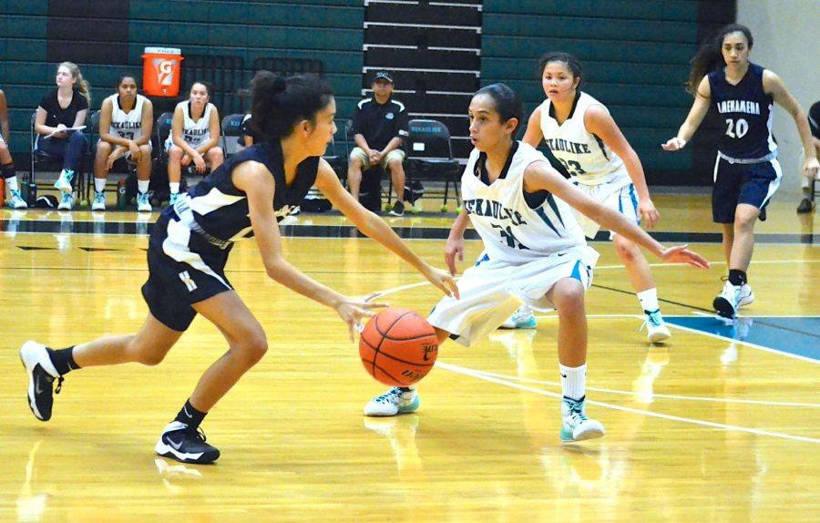 Freshman Analis Nitta takes the ball down half court in the first half of the game. Nitta was one of the leading scorers in the January 15 game against King Kekaulike. Nā Aliʻi won the grudge match 43-45.