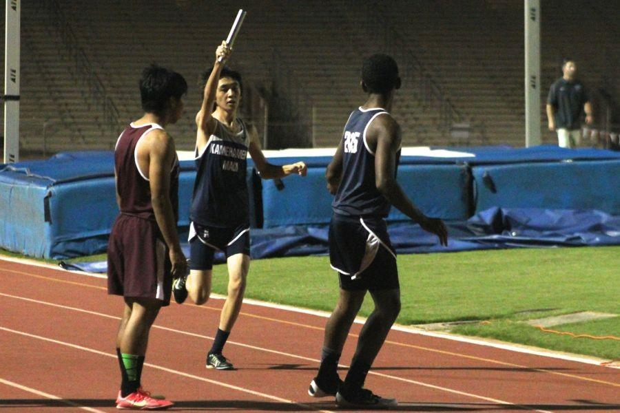 Andrew Amaral hands off to freshman Tyerell Baldonado-Kaleiopu in the boys 4x400 relay at the Maui Interscholastic League Meet 1, a practice meet at War Memorial Stadium, Friday Feb. 27, 2015.